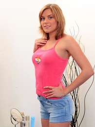 A horny teenage blonde enjoys exposing her pretty snatch pictures at kilosex.com