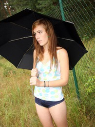 Daring teenage beauty masturbating outdoors in the rain pictures