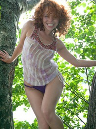 A pretty deranged teenage redhead hanging out in a tree pictures at lingerie-mania.com