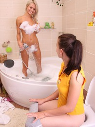 Two teen lesbians love taking a hot horny bath together pictures at freekilosex.com
