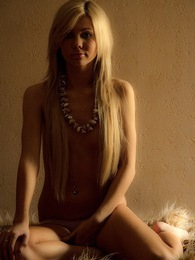 Stunning teenage sweetheart posing naked on a soft carpet pictures at lingerie-mania.com