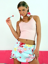 A teenage sweetie loves fondling herself on a big couch pictures at freelingerie.us