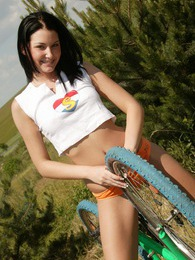 Cute bike riding sweetie rubbing her moist teenage cunt pictures at sgirls.net