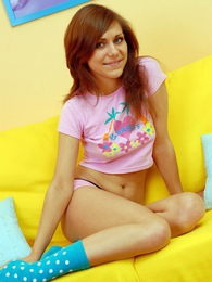 Pleasuring her wet teenage pussy on her own yellow couch pictures at kilogirls.com