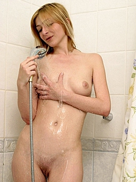 A pretty sweetie fondling herself in the shower with hands pics