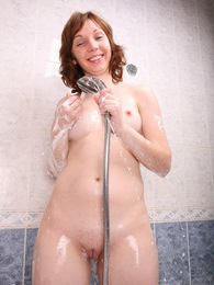 Hot and sexy cutie cleaning her young body with some soap pictures at adspics.com