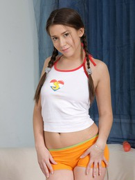 A very hot babe with pigtail pleasures her teenage pussy pictures at adspics.com