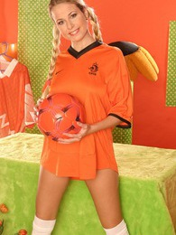 Cute stripping teenage babe loves playing with a football pictures at lingerie-mania.com