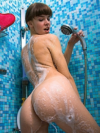 Horny and cute brunette masturbates with her showerhead pictures at adspics.com