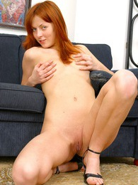 Very horny naked redhead playing with her slippery pussy pics