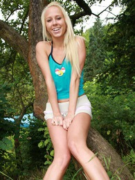 Very sexy blonde teenager sitting in a tree masturbating pictures at adspics.com
