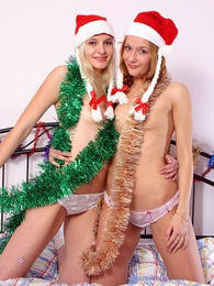 Two lesbian Christmas angels sharing their toys at home pictures
