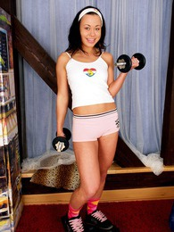 Teenager doing a workout with handles and her favorite dildo pictures at kilosex.com