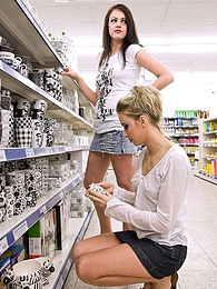 Two teen girls flashing their boobies in a grocery store pictures at find-best-panties.com
