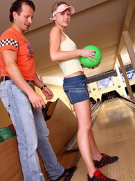 Brunette teen girl pleases a big cock in a bowling alley pictures at lingerie-mania.com