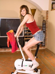 Cute brunete teenie girl doing a sexy workout at her home pictures at freekilopics.com
