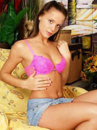 Innocent teenage brunette showing her young firm body parts pictures at freekilopics.com