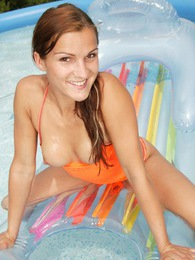 Brunette teen toying tight pussy in a small swimming pool pics