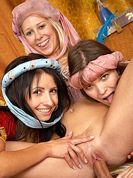 Three teenage harem girls sharing the sultan his erection pictures at freekiloclips.com