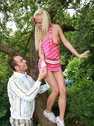 Cute teenage blondie gets boinked while climbing a tree pictures