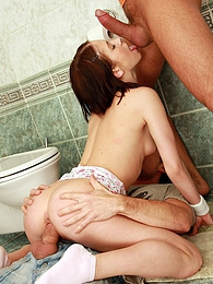 Naughty teenage brunette pleasing two cocks in the toilet pictures at freekiloporn.com