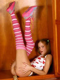 Skinny teenage blonde cutie hiding her secret key inside pictures at kilopics.com