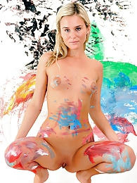 Blonde gets wild and dirty with a bucket of colored paint pictures at freekilopics.com