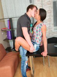This teen couple has sex right on the desk and the floor pictures at freekilomovies.com