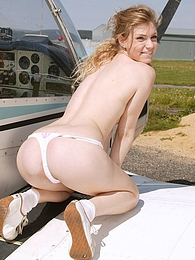 Blonde teenie girl toying her tight pussyhole on a plane pictures at lingerie-mania.com