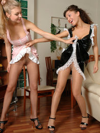 Two French maids in latex uniforms enjoy the feel of their pantyhosed pinks pics