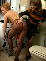 Hot gal seduces luscious blonde into kinky nylon sex right in the bathroom pictures at sgirls.net