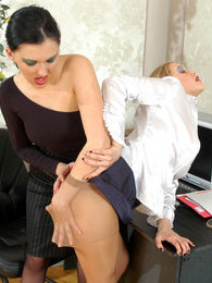 Nylon clad lady-boss seducing her secretary into steamy strap-on fucking pictures