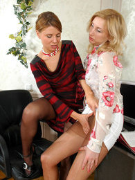 Lady-boss in black pantyhose seducing her secretary and having lesbian sex pictures at freekilosex.com