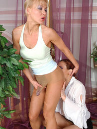 Hottie in tan hose seducing shop assistant into dildo-fucking in doggystyle pictures