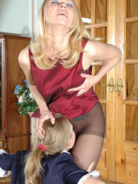 Smashing blondie spying upon French maid warming up her pantyhose clad pink pictures at adspics.com