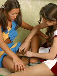 Sporty cheerleaders in soft silky pantyhose getting naughty on the floor pictures at adipics.com