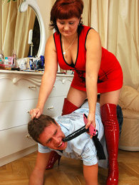 Salacious chick using her huge strap-on punishing a guy for his curiosity pictures