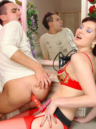 Lustful business woman preparing her strap-on for breathtaking butt-plowing pictures