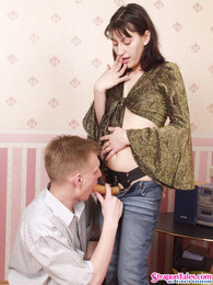 Salacious chick stuffing her strap-on down guy's mouth and up his butthole pictures