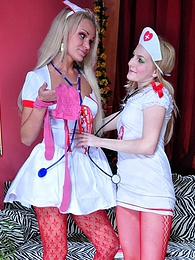 Sexy blonde nurses clad in bright red tights wildly enjoy strap-on fucking pictures at lingerie-mania.com