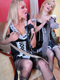 French maids in black tights put to use their sex toy and nylon clad hands pictures at find-best-pussy.com