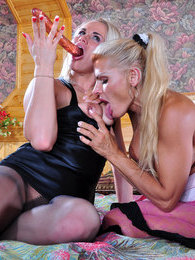 Heated lesbo in pink patterned pantyhose gets involved into a dildo session pictures at kilopills.com