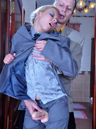 Dressed like a man blondie uses a fat rubber dick for girl-on-guy role play pictures