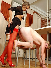 Submissive guy getting his ass packed to the limits with babe's strap-on pictures at freekilosex.com