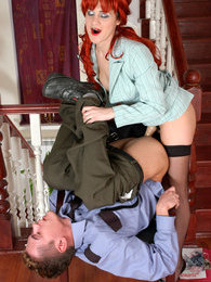 Horny gal sliding her huge strap-on in tight ass of hot guy on the stairs pictures at lingerie-mania.com