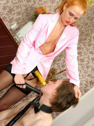 Slutty chick stretching guy's asshole with her yellow strap-on on the floor pictures