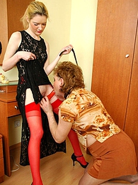 Voluptuous chick with enormous strap-on fucking a sissy guy in doggystyle pictures at freekilopics.com