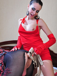 Cross-dressed hunk in crotchless tights strap-on fucked by a lady in red pictures at lingerie-mania.com