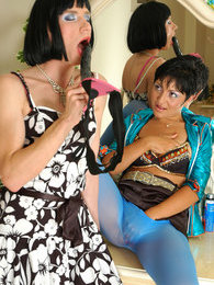 Lewd sissy in a flowered cocktail dress puts his ass to work for strapon fun pictures at lingerie-mania.com