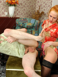 Redhead chick feels like pounding sissy guy's ass with her rubber strap-on pictures at lingerie-mania.com